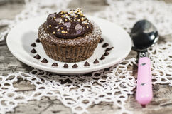 Diet chocolate cupcakes on white plate with pink spoon Royalty Free Stock Photo