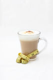 Diet coffee in a glass cup. Tasty coffee with foam for breakfast. The meter suggests healthy lifestyle but still tasty stock image