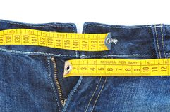 Diet concept. Jeans with measure tape, isolated on white background Royalty Free Stock Photos