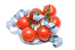 Diet concept. Tomatoes with a tape measure isolated on white background Royalty Free Stock Images