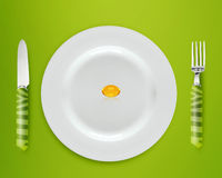 Diet Concept. Cod Liver oil on white plate with knife and fork on blue background Royalty Free Stock Photos