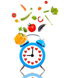 Diet concept, alarm clock with hearts Royalty Free Stock Images