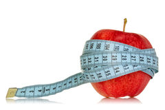 Diet concept with apple and measuring tape Royalty Free Stock Photos