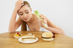 Diet concept.  Beautiful Young Woman eats Lettuce Stock Images