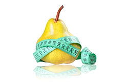 Diet concept with Clipping Path. Close-up of an yellow pear with a measuring tape around on the white background stock photo
