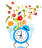 Diet concept with clock, scale dial Royalty Free Stock Photo