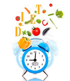 Diet concept with clock. Scale dial and vegetables Royalty Free Stock Image