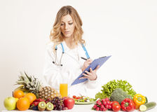 Diet concept. Female dietitian in uniform with stethoscope Stock Image