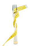 Diet concept, fork and measuring tape Stock Images