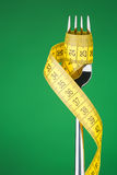 Diet Concept - Fork and Measuring Tape Royalty Free Stock Photos