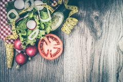 Diet concept  with fresh lettuce, onion, radish, tomato and cucu. Mber on wooden background. With empty space for your text. View from above Royalty Free Stock Photography
