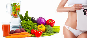 Diet concept, fresh vegetables. Woman with weight scale. Royalty Free Stock Photo