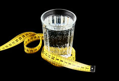 Diet concept, glass of water and measuring tape Stock Photo
