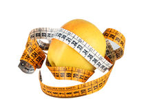 Diet concept with green apple wrapped with measuring tape Royalty Free Stock Images