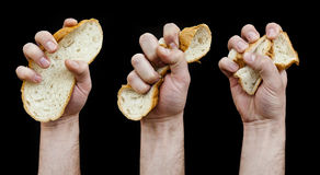 Diet concept. Hand crumple a slice of bread. Royalty Free Stock Images