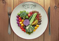 Diet concept heart shape fruit and vegetables Stock Images