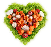 Diet concept heart shape lettuce carrots radishes. On white background Royalty Free Stock Images
