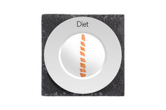 Diet. Concept Image for Diet with Chopped Carrot on a White Plate and Black Slate Board Isolated with a White Background Stock Photo