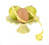 Diet concept, kiwi fruit with green apple and measuring tape Royalty Free Stock Photo