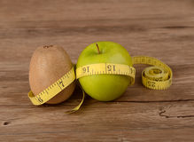 Diet concept, kiwi fruit with green apple and measuring tape Stock Photo