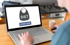 Diet concept on a laptop. Man using a laptop with diet concept on the screen stock photos