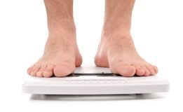 Man standing on weight scale stock photos