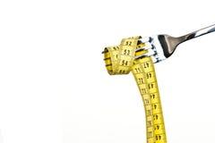 Diet concept. Metallic fork Stock Photo