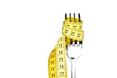 Diet concept. Metallic fork Stock Photos