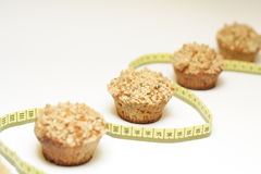 Diet concept with muffins and yellow centimeter Stock Image