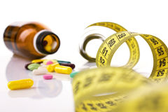 Diet concept with pills and centimeter Stock Photo