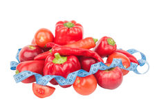 Diet concept: Set from red bell pepper, red hot chili pepper and apple with measuring tape Royalty Free Stock Images