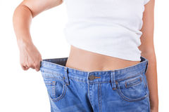 Diet Concept. Slim Women in Big Jeans Showing Successful Weight. Loss extreme closeup Stock Photo