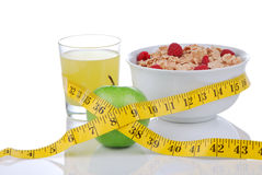 Diet concept:tape measure, apple, glass of juice. Diet weight loss concept with tape measure green and organic green apple, corn healthy rice and wheat flakes Stock Photos