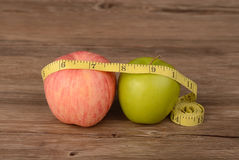 Diet concept,two apples on wood Stock Photography
