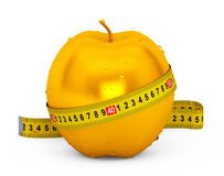 Diet Concept. Wet Golden Apple with Yellow Measuring Tape Stock Images