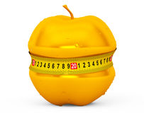 Diet Concept. Wet Golden Apple with Yellow Measuring Tape Royalty Free Stock Photography