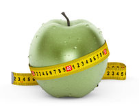 Diet Concept. Wet Green Apple with Yellow Measuring Tape Stock Photos