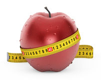 Diet Concept. Wet Red Apple with Yellow Measuring Tape Royalty Free Stock Photography