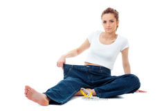 Diet concept, woman shows her old huge jeans Stock Photo