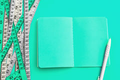 Diet control concept background. Colorful of Measuring tape on v Stock Images