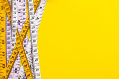 Diet control concept background. Colorful of Measuring tape on v Stock Photography