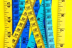 Diet control concept background. Colorful of Measuring tape on v Royalty Free Stock Photography
