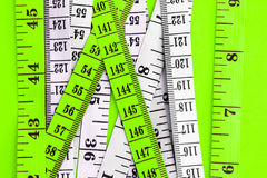 Diet control concept background. Colorful of Measuring tape on v Stock Photo