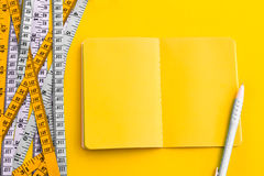 Diet control concept background. Colorful of Measuring tape on v Stock Photos