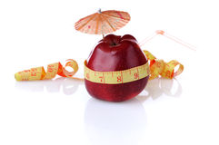 Diet for control of weight. Red apple with umbrella and tube is measured by centimetre Stock Photography
