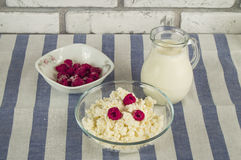 Diet cottage cheese with fresh raspberries and milk.  Stock Images