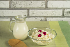 Diet cottage cheese with fresh raspberries and milk.  Royalty Free Stock Photography