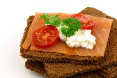 Diet cracker with salmon, cheese and tomato Stock Photo