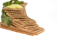 Diet crackers with parsley and butter. Royalty Free Stock Photos