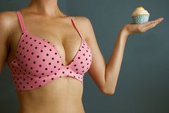 Diet and delicious cupcakes Stock Photography